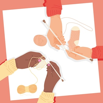 Mãos segurando agulhas de tricô com fios
