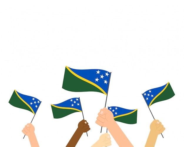 Mãos segurando bandeiras das ilhas salomão