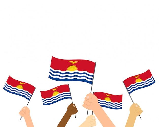 Mãos segurando bandeiras de kiribati