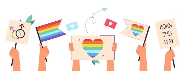 Mãos segurando bandeiras e cartazes de arco-íris