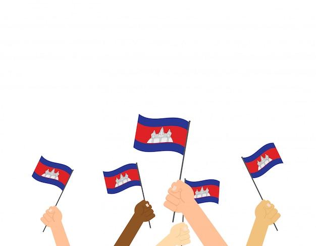 Mãos, segurando, cambodia, bandeiras