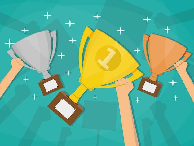 Mãos segurando copos de troféus vencedor.