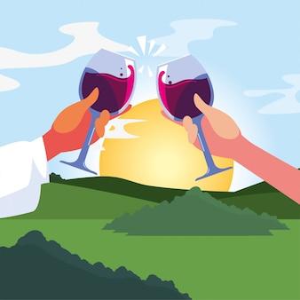 Mãos segurando copos de vinho na frente da paisagem
