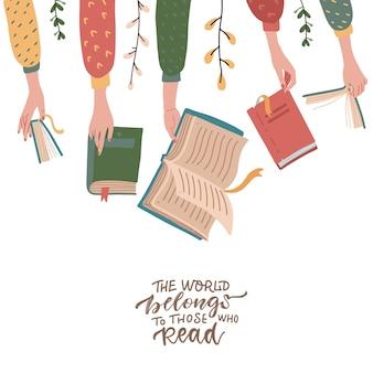 Mãos segurando livros. citação de letras - o mundo pertence a quem lê.