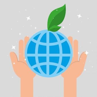 Mãos segurando o planeta com uma folha