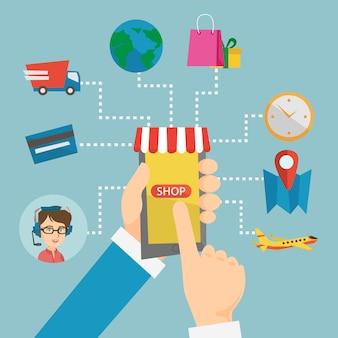 Mãos segurando o telefone conectado com elementos de compras.