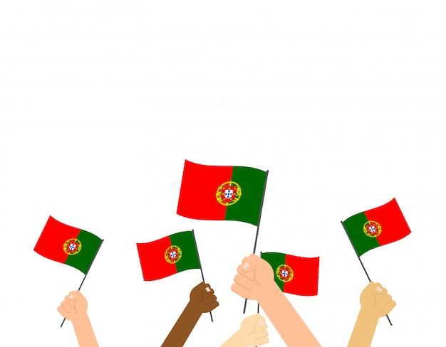 Mãos, segurando, portugal, bandeiras