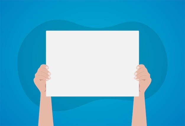 Mãos segurando um cartaz branco vazio