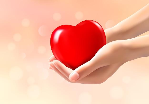 Mãos segurando um coração vermelho.