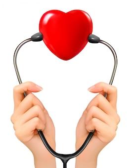 Mãos segurando um estetoscópio com coração vermelho.