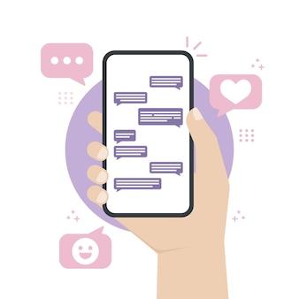 Mãos segurando um smartphone enquanto envia mensagem ou conversa com outras pessoas