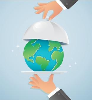 Mãos segurando uma prata cloche com terra. dia mundial da comida