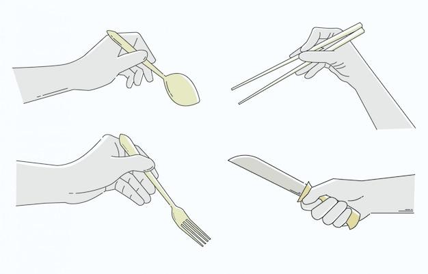 Mãos segurando utensílios de mesa