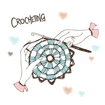 Mãos tricotando um guardanapo