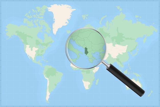 Mapa do mundo com uma lupa no mapa da albânia.