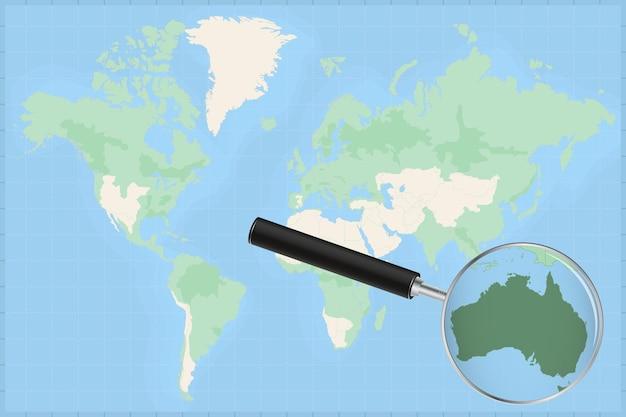 Mapa do mundo com uma lupa no mapa da austrália.