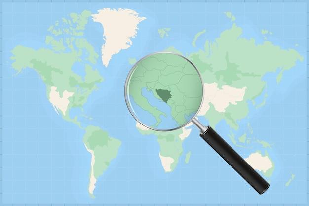 Mapa do mundo com uma lupa no mapa da bósnia e herzegovina.