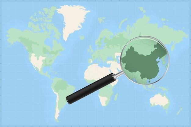 Mapa do mundo com uma lupa no mapa da china.