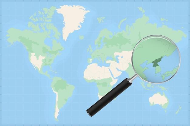 Mapa do mundo com uma lupa no mapa da coreia do norte.