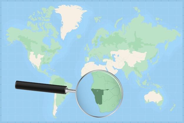 Mapa do mundo com uma lupa no mapa da namíbia.