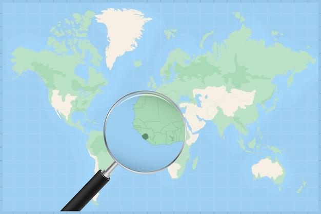 Mapa do mundo com uma lupa no mapa da serra leoa.