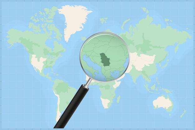 Mapa do mundo com uma lupa no mapa da sérvia.