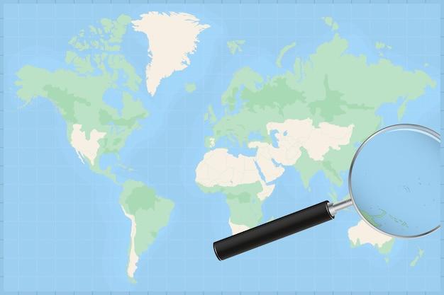 Mapa do mundo com uma lupa no mapa das ilhas marshall.