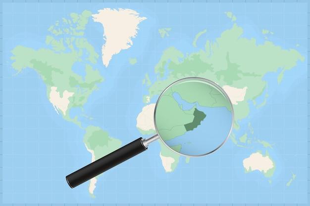 Mapa do mundo com uma lupa no mapa de omã.