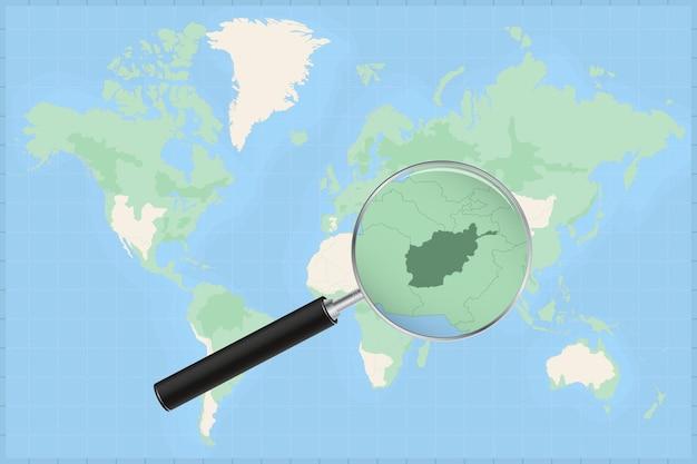 Mapa do mundo com uma lupa no mapa do afeganistão.