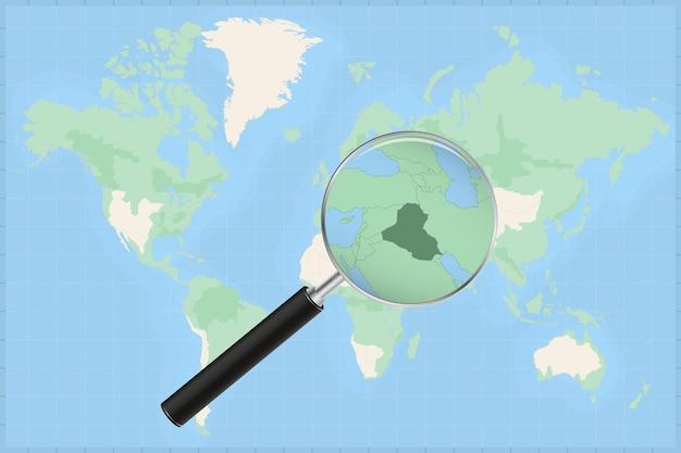 Mapa do mundo com uma lupa no mapa do iraque.