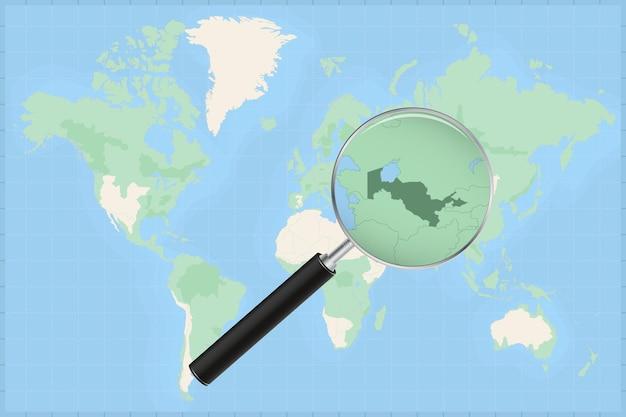Mapa do mundo com uma lupa no mapa do uzbequistão.