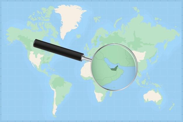 Mapa do mundo com uma lupa no mapa dos emirados árabes unidos.