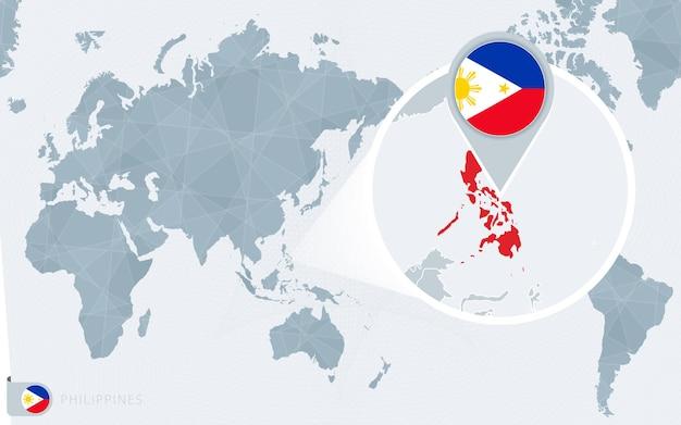 Mapa-múndi centrado no pacífico com as filipinas ampliadas. bandeira e mapa das filipinas.