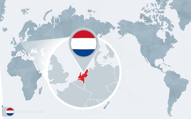 Mapa mundial centrado no pacífico com a holanda ampliada. bandeira e mapa da holanda.