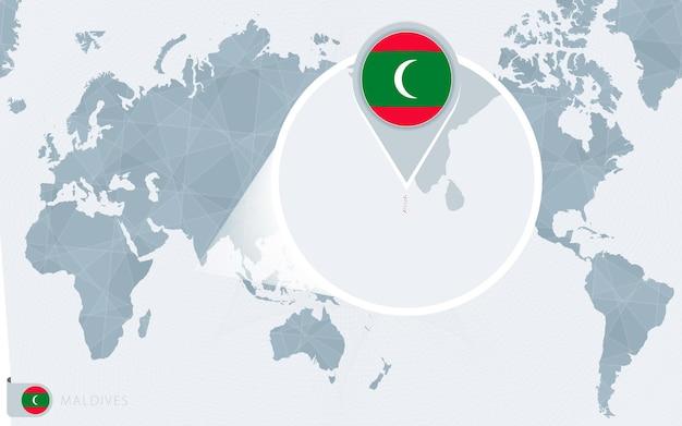 Mapa mundial centrado no pacífico com as maldivas ampliadas. bandeira e mapa das maldivas.