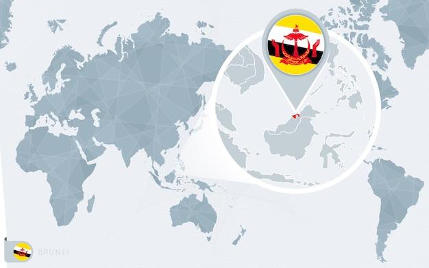 Mapa mundial centrado no pacífico com brunei ampliado. bandeira e mapa de brunei.