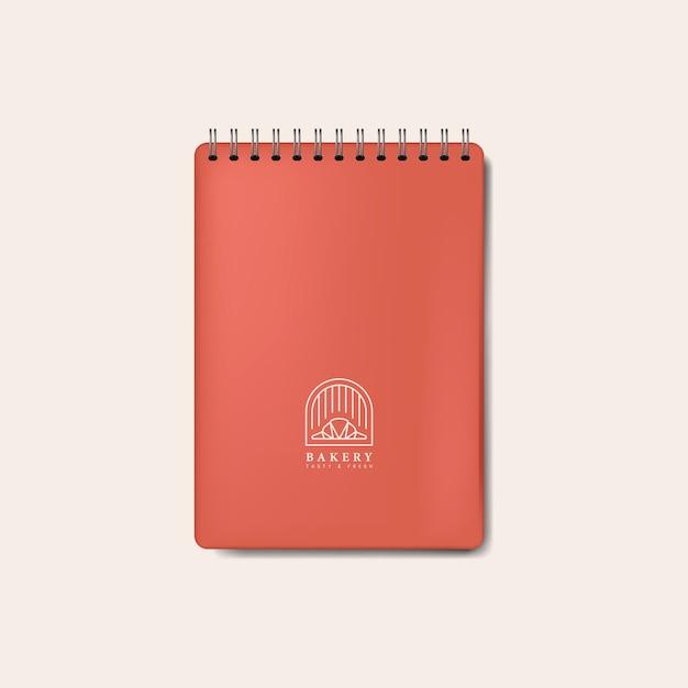 Maquete de caderno vermelho espiral