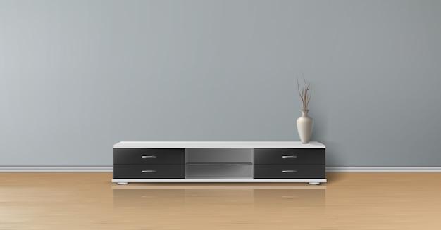 Maquete realista de sala vazia com parede plana cinza, piso de madeira, suporte de tv com gavetas pretas