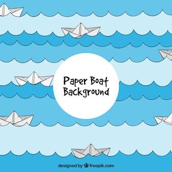 Mar fundo com barcos de papel