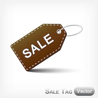 Marca de venda de couro com laço de metal no fundo branco
