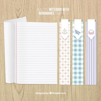 Marcadores de livro e um caderno listrado