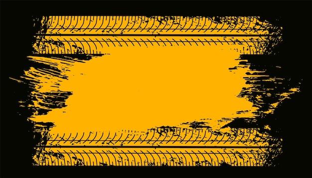 Marcas de impressão da trilha do pneu na textura amarela do grunge