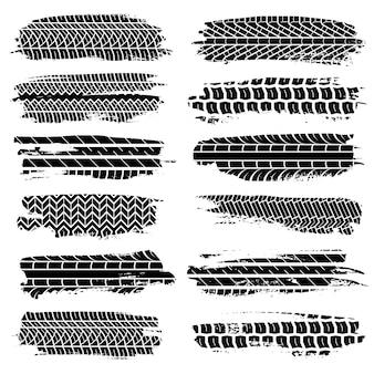 Marcas de pneus de grunge. conjunto de elementos de pneus bagunçados de motocicleta de carro, rastreamento de trator grunge na estrada, textura suja de rally de motocross das rodas, coleção de silhueta isolada de vetor preto