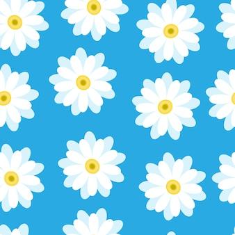 Margaridas brancas sobre um fundo azul