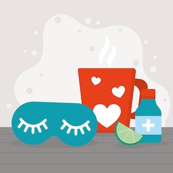 Máscara de dormir e caneca de chá