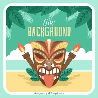 Máscara tiki irritada com tochas na praia