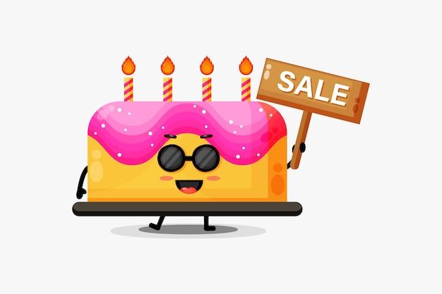 Mascote de bolo de aniversário fofo com placa de vendas