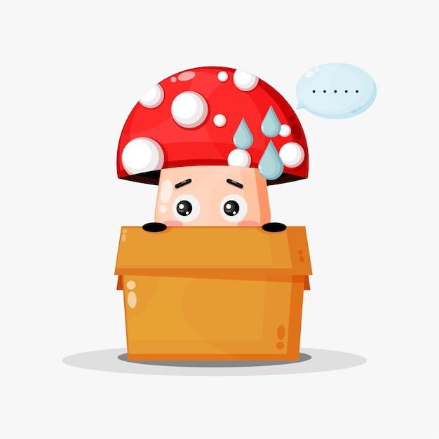 Mascote de cogumelo fofo na caixa