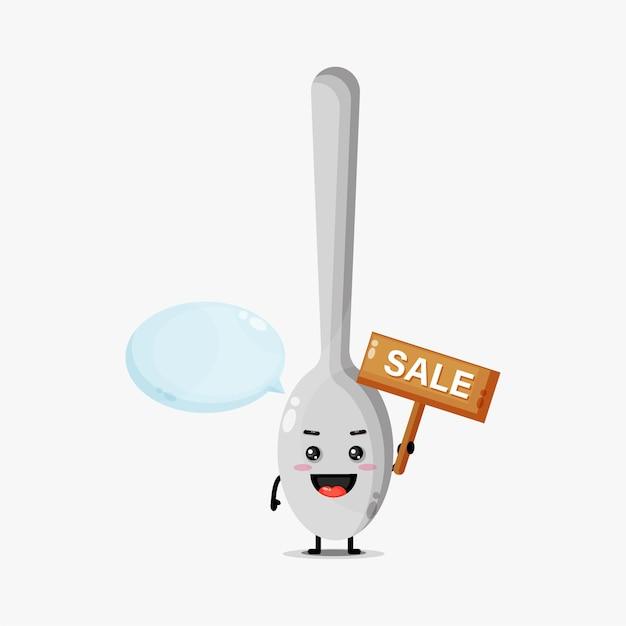 Mascote de colher fofinho com o sinal de venda