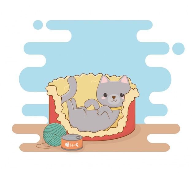 Mascote de gato pequeno bonito na cama com lata de atum e rolo de lã
